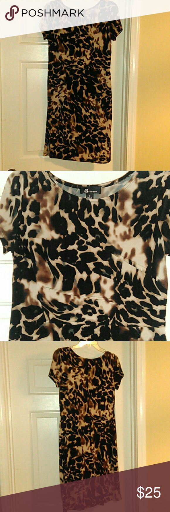 Animal print dress Short sleeve dress by AB Studio  Very flattering details on left side of dress runs across torso area  95% polyester/5% spandex  Size small fits like 6-8 AB Studio Dresses