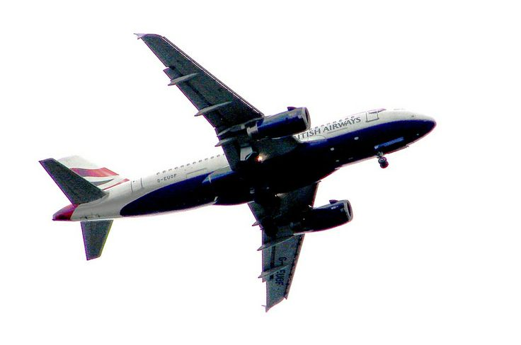 British Airways flying over Kew Gardens on its approach to Heathrow Airport, London UK