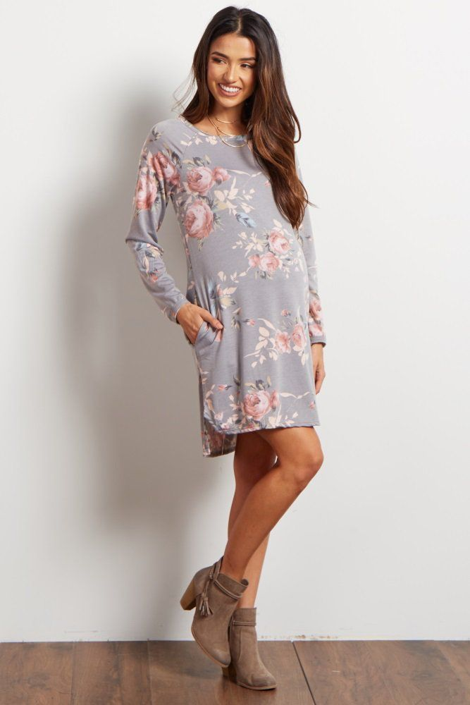 A floral printed maternity sweater dress. Rounded neckline. Long sleeve. This style was created to be worn before, during, and after pregnancy.
