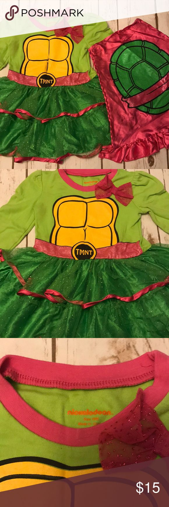 Toddler Girl Nickelodeon Ninja Turtle Tutu Dress GUC- Dress itself is in EUC, the detachable cape is in GUC because there are a couple of pulls at the upper right hand corner of cape- see the last pic. Overall this is just such a super cute dress for your little girl. It's Nickelodeon brand sized 18 months. Top half of dress is a tee shirt material and bottom half is layered tulle. Cape can be attached or removed easily with Velcro tabs that are part of the dress. Smoke free home Nickelodeon…