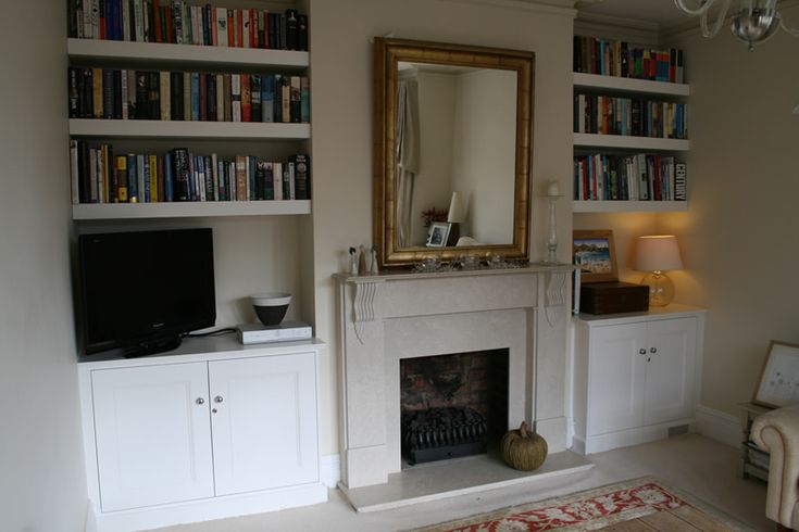 Lovely example of alcove shelving done right with space for a TV and thick floating bookshelves