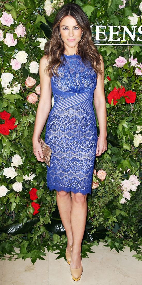 ELIZABETH HURLEY Hurley showed us she's still got it, flaunting her figure in a Queenspark sheath dress with a blue lace overlay, pairing it with a snakeskin clutch and nude platform pumps.