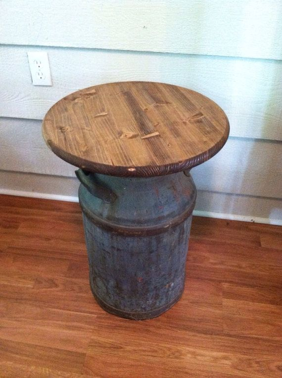 I love the patina on this antique milk can table! The milk can is solid metal and would be a wonderful accent in your home. The top is solid wood and stained and sealed. Use this table as a side table or nightstand. Dimensions are 18 in diameter and 24 in tall. PLEASE CONTACT ME FOR AN EXACT SHIPPING QUOTE BEFORE PURCHASING. There is a charge for shipping.