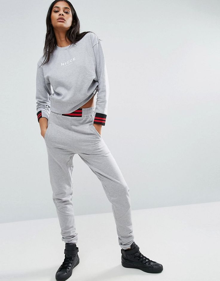 Buy it now. Nicce London Logo Joggers - Grey. Sweatpants by Nicce London, Soft-touch sweat, Stretch waistband, Striped waist insert, Side and back pockets, Fitted cuffs, Slim fit - cut close to the body, Machine wash, 100% Polyester, Our model wears a UK S/EU S/US XS and is 175cm/5'9 tall. ABOUT NICCE LONDON Inspired by London�s ever-changing music scene, Brit label Nicce London is here to up your style game. Known for its contemporary cool designs, its slouchy oversized boyfriend…