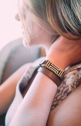 Transform your Fitbit Flex® tracker into a super chic accessory with this exclusive collection from Tory Burch.