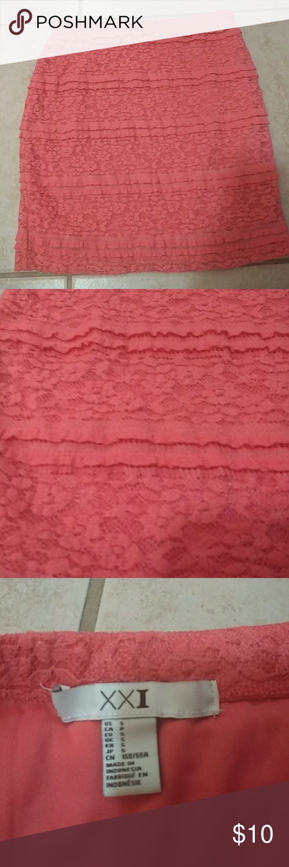 Coral lace pencil skirt size small This comfy and stylist slim-fitting skirt has a stretch elastic waist. Horizontal lace panels with miniature ruffles add a sexy vibe. Coral color stands out and is perfect for spring and summer! Lined for comfort. No pulls on the lace or any stains. Perfect condition. XXI Skirts Pencil