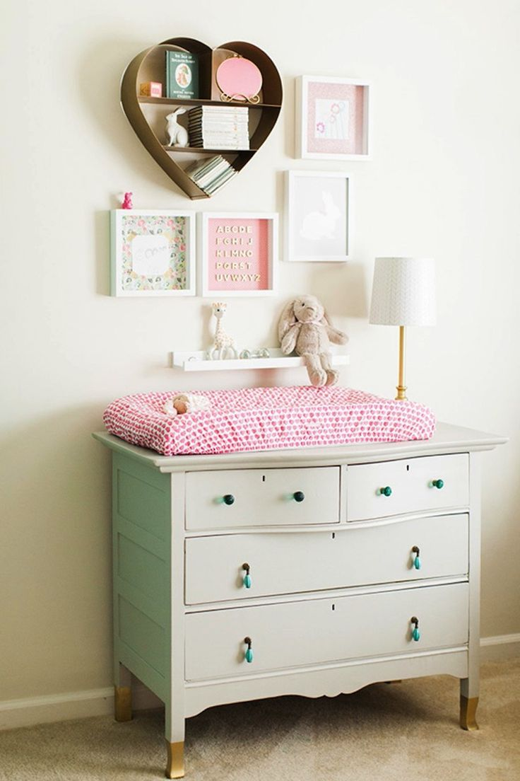 Love the styling of this heart-shaped shelf and gallery wall over the changing table!