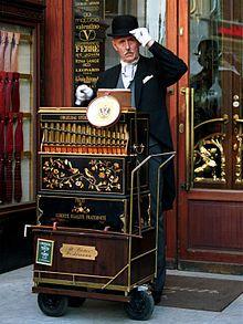 An Austrian organ grinder (locally called Werklmann) with his paper-roll driven Berlin style barrel organ in Vienna