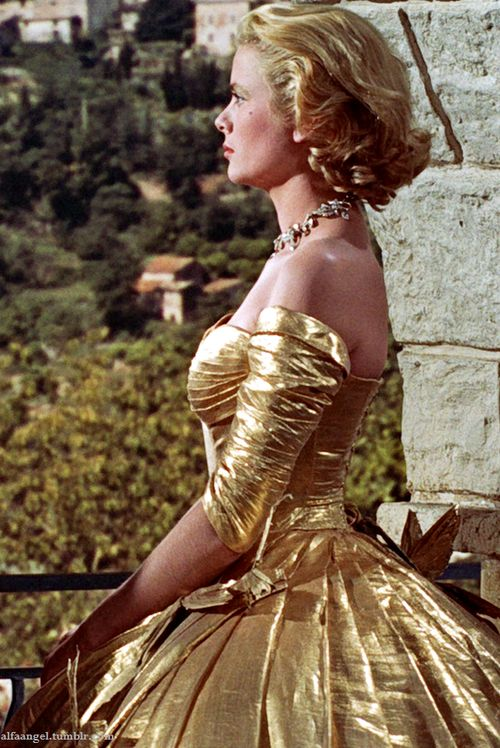 Grace Kelly in Edith Head golden gown - 'To Catch a Thief', 1955. gold lame 50s color photo print ad movie star model designer couture full skirt off shoulder evening cocktail dress