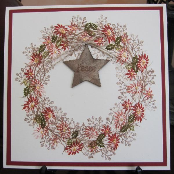 Created a wreath with Card-io & Tapestry stamps using Versafine & Distress inks. Stickles, liquid pearls and a wooden star, which I stamped with a 'peace' stamp added. TFL