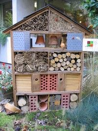 how to build an insect hotel to attract pollinators and pest-eating bugs of all kinds! includes materials to use.  NEAT!