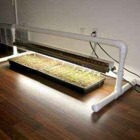 DIY PVC grow light stand. Learn how to make this at http://www.vegetablegardener.com/item/10376/diy-pvc-grow-light-stand