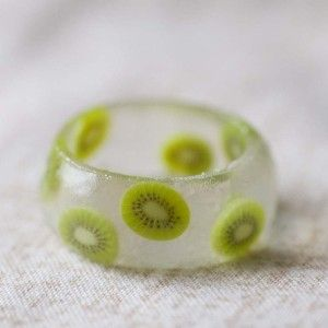 Resin ring with clay cane fruit! what a cute idea.