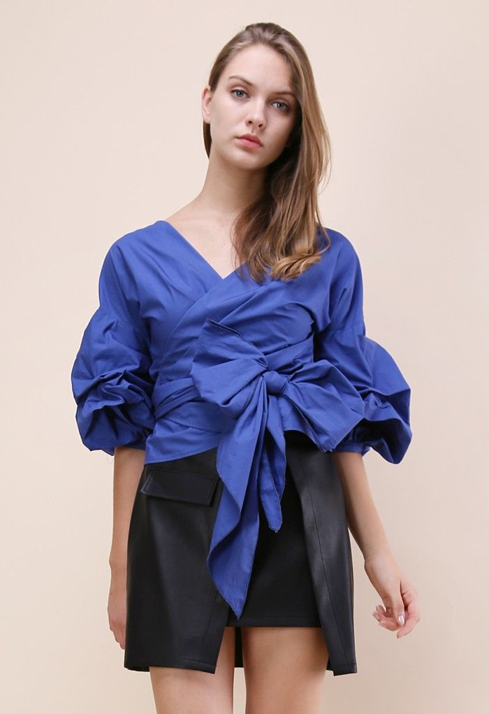 Ruffles, draping and cold shoulders oh my! This enchanting top, even in all its navy-draped glory, holds a casual element that makes it suitable for your casual date nights and fancier occasions.  - Decollete neckline - Ruche sleeves - Self-wrapped through keyhole on waist - Cotton 80%,Polyester 20% - Hand wash cold    Size(cm)  Length Bust Shoulder Sleeves XS         57     84  &...