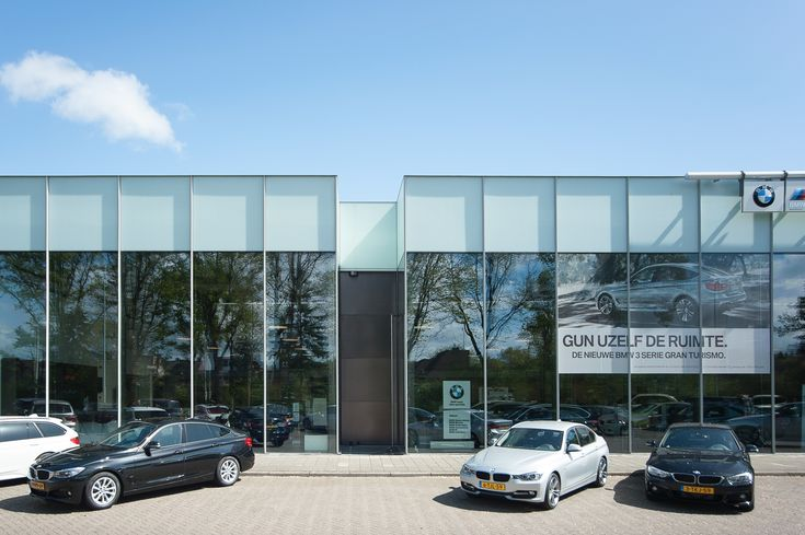 Extreme dimensioned automatic pivot door  Van Laarhoven BV, authorized BMW and Austin Martin dealer in the Eindhoven region.