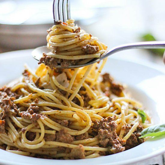 Indulge your pasta craving with this creamy, slow cooker rich meat sauce. One of the best meat sauces I've tasted!