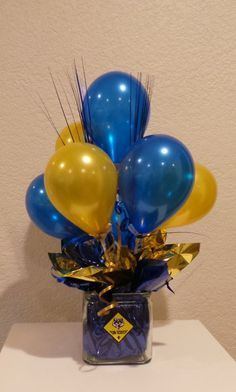 "Blue and Gold Balloon Centerpiece using 5"" balloons."