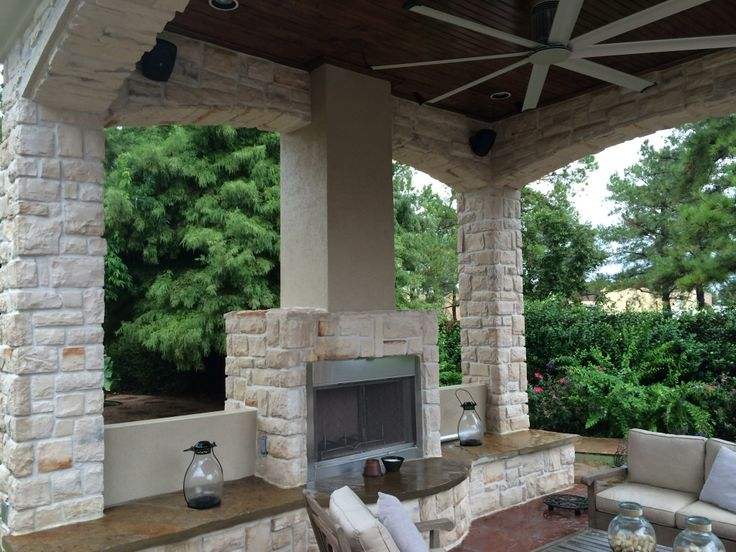 This Houston Outdoor Sitting Area Contains A Gas Fireplace With Bench  Seating, An Outdoor Ceiling Fan, Outdoor Sofas And A Coffee Table. This Is  One Of The ...
