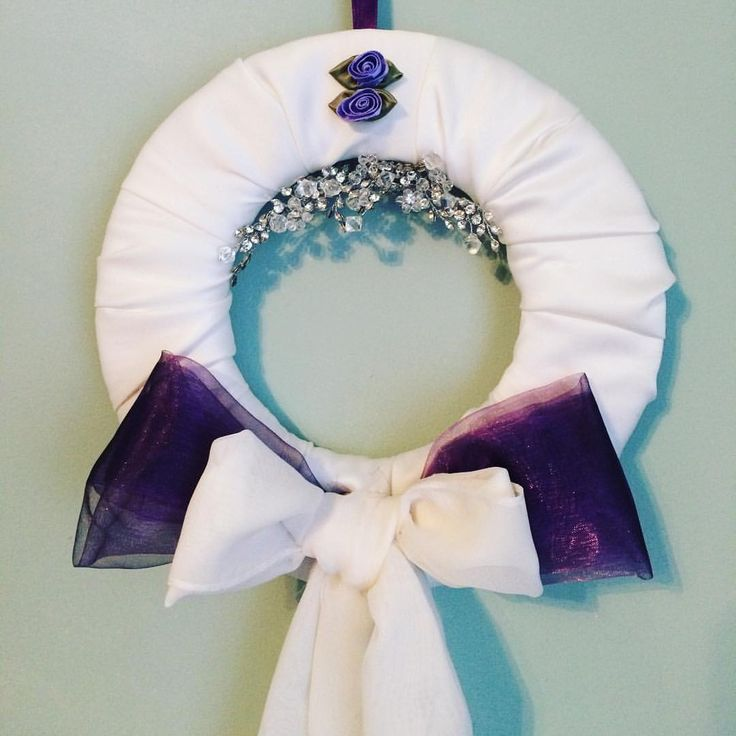 Wedding wreath. Used the train off my wedding dress, my hairpiece and purple table runners to make a commemorative wreath of my wedding day.