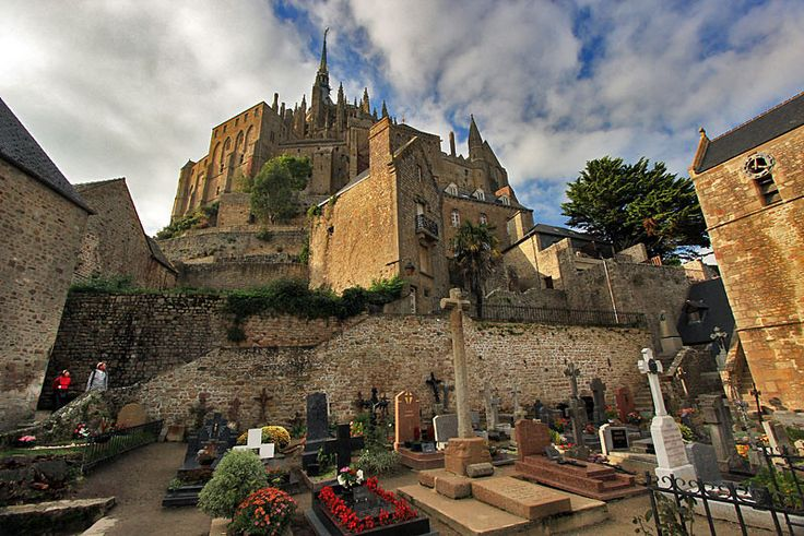 Small Cemetery Beneath Mont St. Michel Abbey and Fortress in Normandy, France