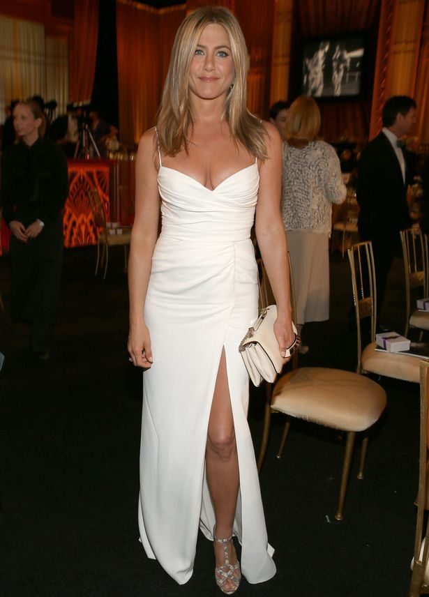 Jennifer, pictured here in white, shunned the traditional celeb wedding dress