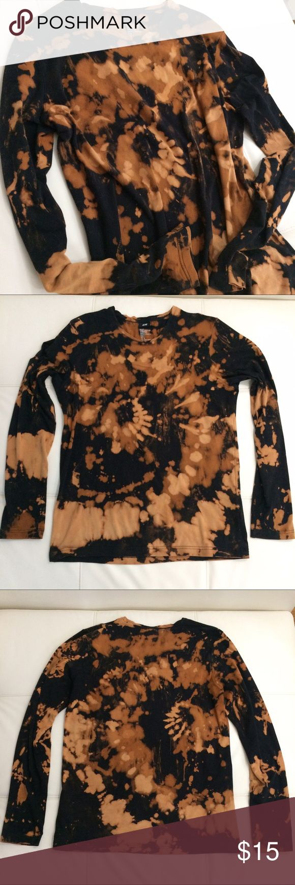 New Listing  H&M bleached long sleeve Black long sleeve tee. Bleach pattern design- bough like this from H&M. Size L. Looks awesome oversized with leggings or skinny jeans. H&M Tops