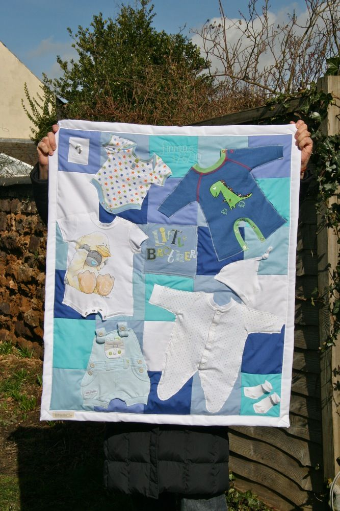 Little boys memory quilt using whole applique outfits on a patchwork background...by me!
