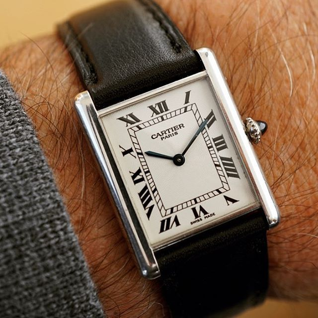 Cartier Tank Louis in platinum on black calf leather strap.