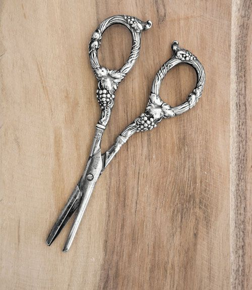 I great collectible: interesting sterling silver serving pieces for the table.  These are grape shears.