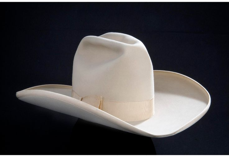 Tom Mix was a silent films star who made ten-gallon cowboy hats (such as this one, made by John B. Stetson Company) his trademark, and popularized the look around the country. #cowboy #hat