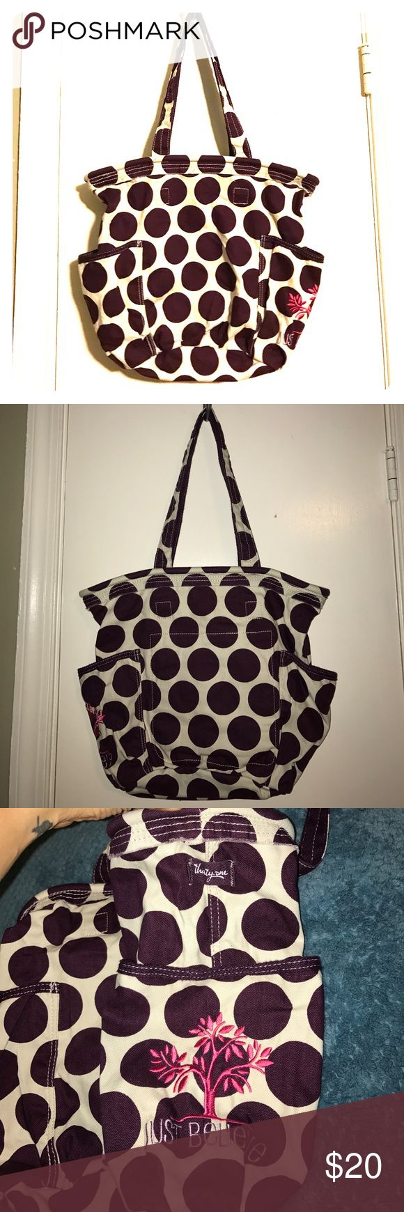 Retro Metro Tote 👜 in Maroon Mod Dot pattern NWOT NWOT Retro Metro Tote, off White with maroon Mod dots. Two outer pockets, two inner pockets and one zipper pocket. Has a clip to attach keys. last picture shows you the style, it's supposed to have the frayed look. Bundle and save, open to reasonable offers. Comes from a smoke free 🐶 friendly home. Let me know if you have any questions. Thirty-One Bags Shoulder Bags