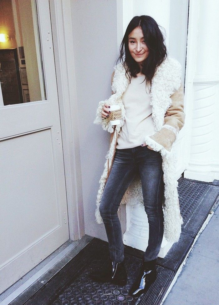 Aziza Azim grabs coffee in a luxe shearling jacket and messy weekend hair.