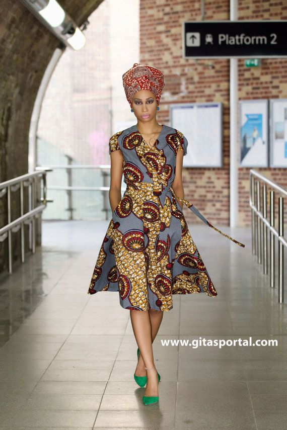 The easy to wear wrap dress is flattering on any shape and size. Has side pockets. Full Length: 42-44 inches.  Size conversion  UK10 - US 6 (bust 34inches, waist 28 inches) UK12 - US 8 (bust 36inches, waist 30 inches) UK14 - US 10 (bust 38inches, waist 32 inches) UK16 - US 12 (bust 40inches, waist 34 inches) UK18 - US 14 (bust 42inches, waist 36 inches) UK20 - US 16 (bust 44inches, waist 38 inches) UK22 - US 18 (bust 46inches, waist 40 inches)    Any questions, please convo me.