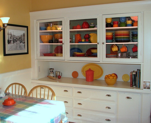 Fiestaware / Craftsman-style hutch. Makes me think of my mom, who owns every Fiestaware color.  She could have a dinner party for 30. :)