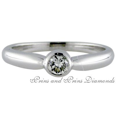 Making it's way back into the top ten favourite designs....the classic bezel set diamond ring.