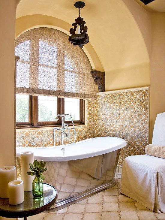 Spanish Origins..Spanish style abounds in this master bathroom retreat from the warmth of golden-yellow walls to the ornate tilework to a metal-side tub reflective of Spanish pewter.
