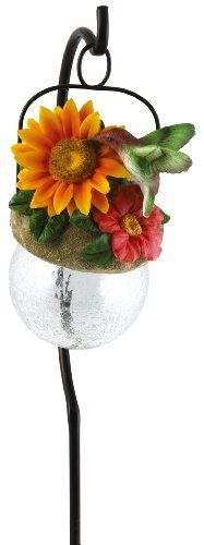 Moonrays 92261 Hummingbird-Bird Sits on Hanging-Glow-Ball Solar Light, Garden Art, Hummingbird Pendant Shape by Moonrays. $20.59. From the Manufacturer                Moonrays 92261 Hummingbird-Bird Sits on Hanging-Glow-Ball Solar Light, Garden Art, Hummingbird Pendant Shape. For bird lovers, bird watchers, and gardeners, we created a line of Outdoor hanging Pendant lamps. Each is solar powered to gather energy from sunlight, to automatically glow at night. This fi...
