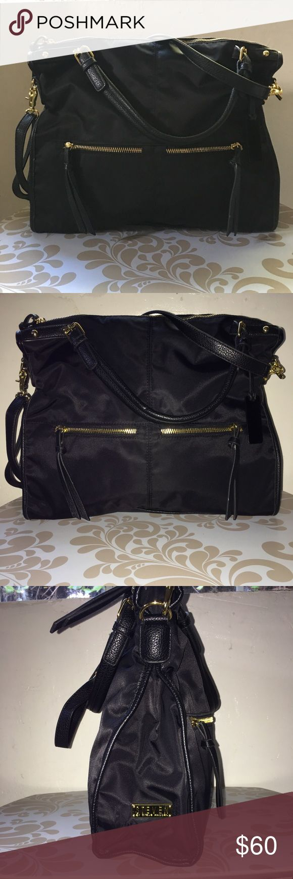 """Steven by Steve Madden Large Crossbody Handbag This is a like new Steven by Steve Madden Black handbag, with gold hardware. Features a detachable strap and two handles. The name plate is on the side as pictured. It is a medium to large sized handbag pls refer to measurement to avoid confusion. If you have any questions feel free to ask.  Width:5""""  Length: 17""""  Depth: 15"""" Steven By Steve Madden Bags Crossbody Bags"""