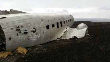 This wrecked airplane husk has been sitting on a black sand beach since the 1970s