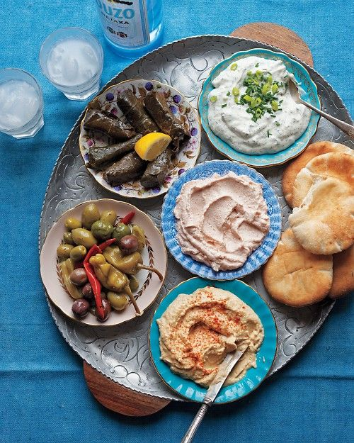 Tzatziki, taramasalata, hummus, a mix of olives and peppers, and dolmades in Santorini