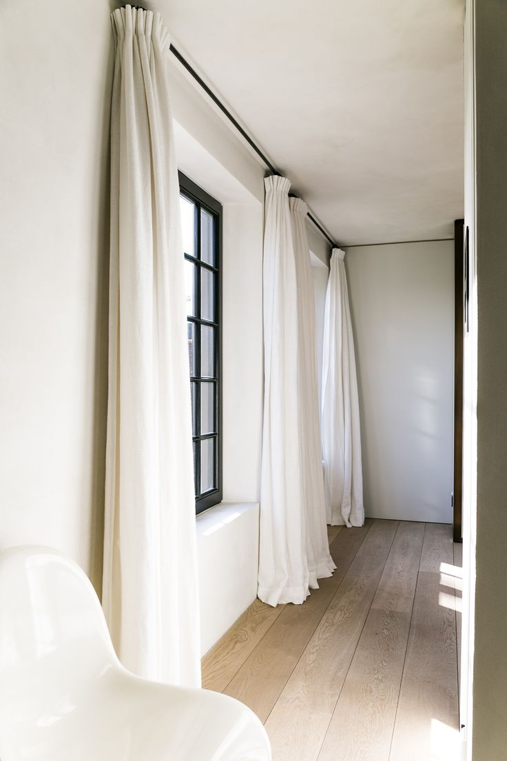 White curtains and black rods