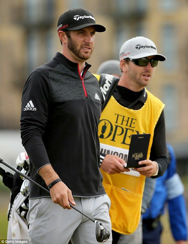 Austin Johnson caddies for brother Dustin Johnson. They are seen together here during the third round of the 144th Open Championship at The Old Course on July 19, 2015, in St Andrews, Scotland