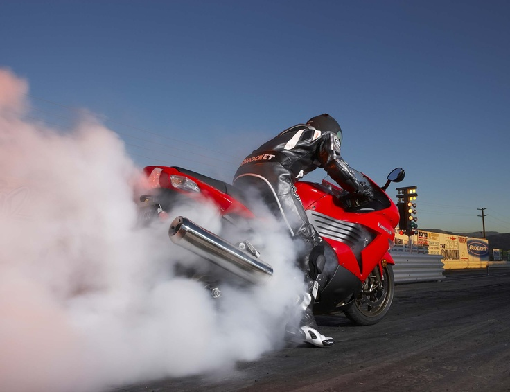 Google Image Result for http://image.sportrider.com/f/8728826/146_0606_08_z+2006_kawasaki_zx14+red_burnout.jpg