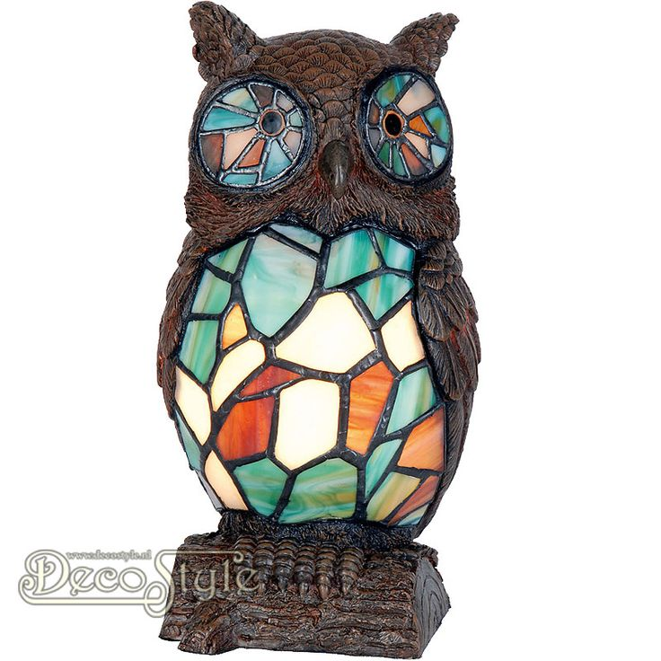 Tiffany Dierenlamp Lagan Owl  Decoratieve Tiffanylamp in de vorm van een uil op een tak. Helemaal met de hand gemaakt van echt Tiffanyglas. Dit originele glas zorgt voor de warme uitstraling. De kop en de tak zijn gemaakt van polystone. Met 1x kleine fitting (E14) Max 40 Watt. Met schakelaar aan het stroomsnoer. Afmetingen: Hoogte: 24 cm Breedte: 13 cm Diepte: 13 cm
