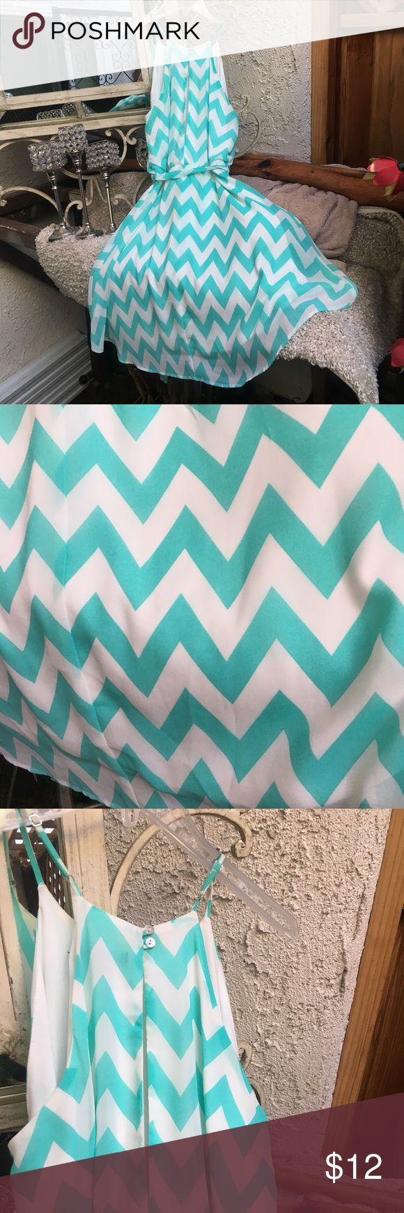 Teal & White Chevron Print Dress Very pretty teal and white chevron print chiffon dress with elastic waist, ribbon tie and full skirt. Fully lined, I went without bra no problem. The cut and style of dress is very flattering - only dress I wore at my waist and liked 👌 stuccatto Dresses Midi