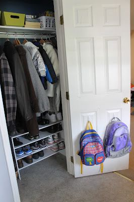 move the closet rod up to make extra room for shoe storage in the hall closet