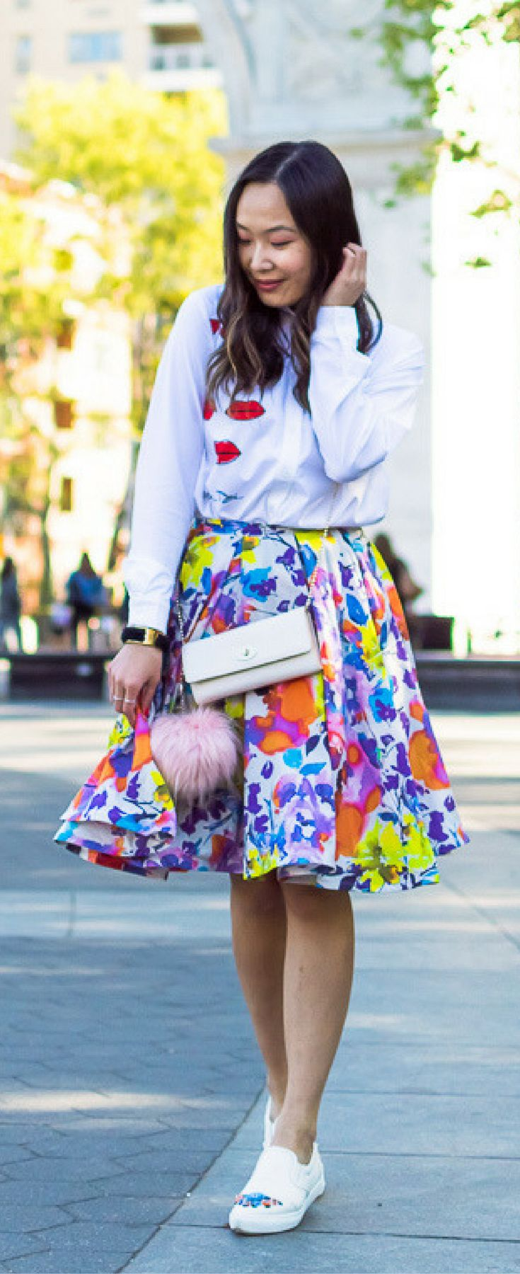 Flirty outfit classy, watercolor skirt outfit, lip print blouse, feminine outfit ideas. Get the look on www.layersofchic.com