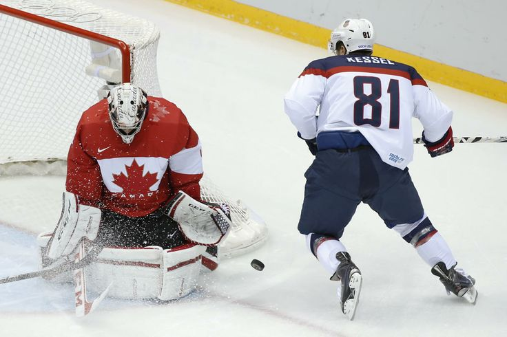 Men's hockey semifinals - USA vs. Canada USA forward Phil Kessel shoots on Canada goaltender Carey Price during the first period of the m...