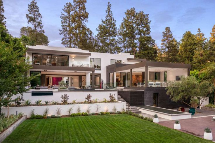 This home in California has a large backyard with swimming pool and multiple outdoor entertaining areas.