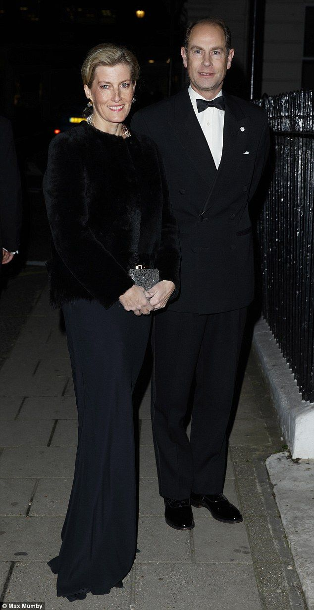 Sophie Wessex looked stunning in a long black dress with a matching fur jacket, as she arrived at the John Adie exhibition at Buck's Club with her husband Prince Edward